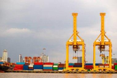 Shipping port. Cargo ship loading by crane