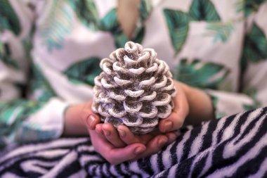 decorative white cone in hands