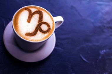 Top view of hot coffee cappuccino latte art in a ceramic glass