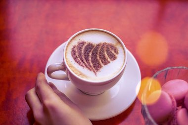 hot coffee cappuccino with latte art of romantic heart.