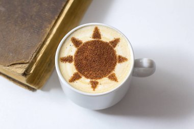 hot cappuccino coffee with sun symbol latte art in white cup