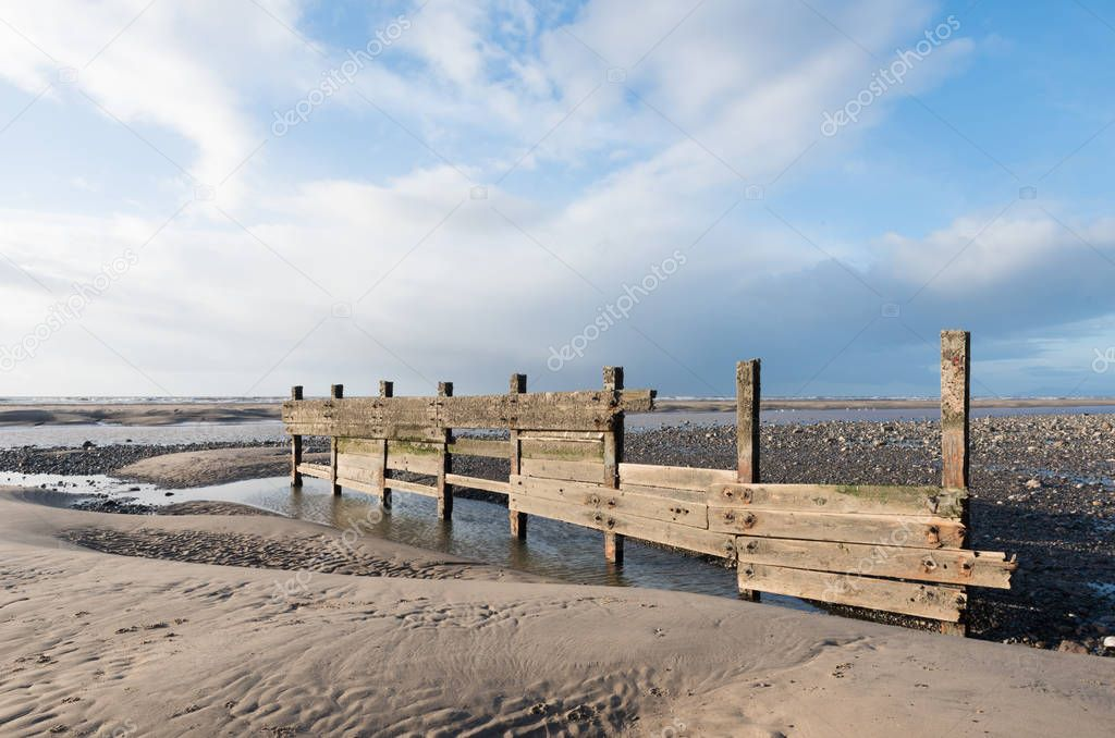 cleveleys, england, 02/17/2016, A rustic, weathered wooden sea defence wall, showing signs of damage