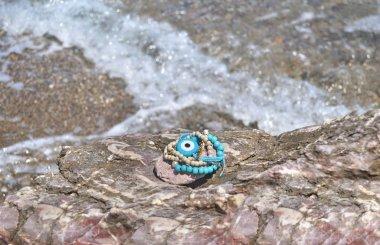 greek summer bracelets with evil eye on beach