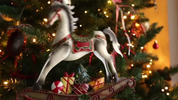 Decorative Christmas Horse Moving In Front Of The Christmas Tree