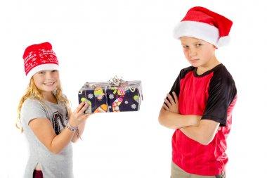 Siblings exchange a christmas present