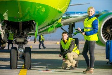 airport workers handling airplane