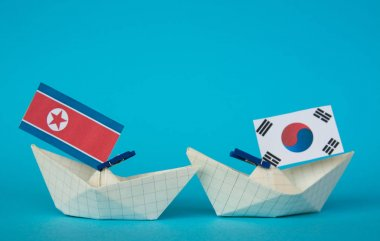 paper ship with Flags of North Korea and South Korea