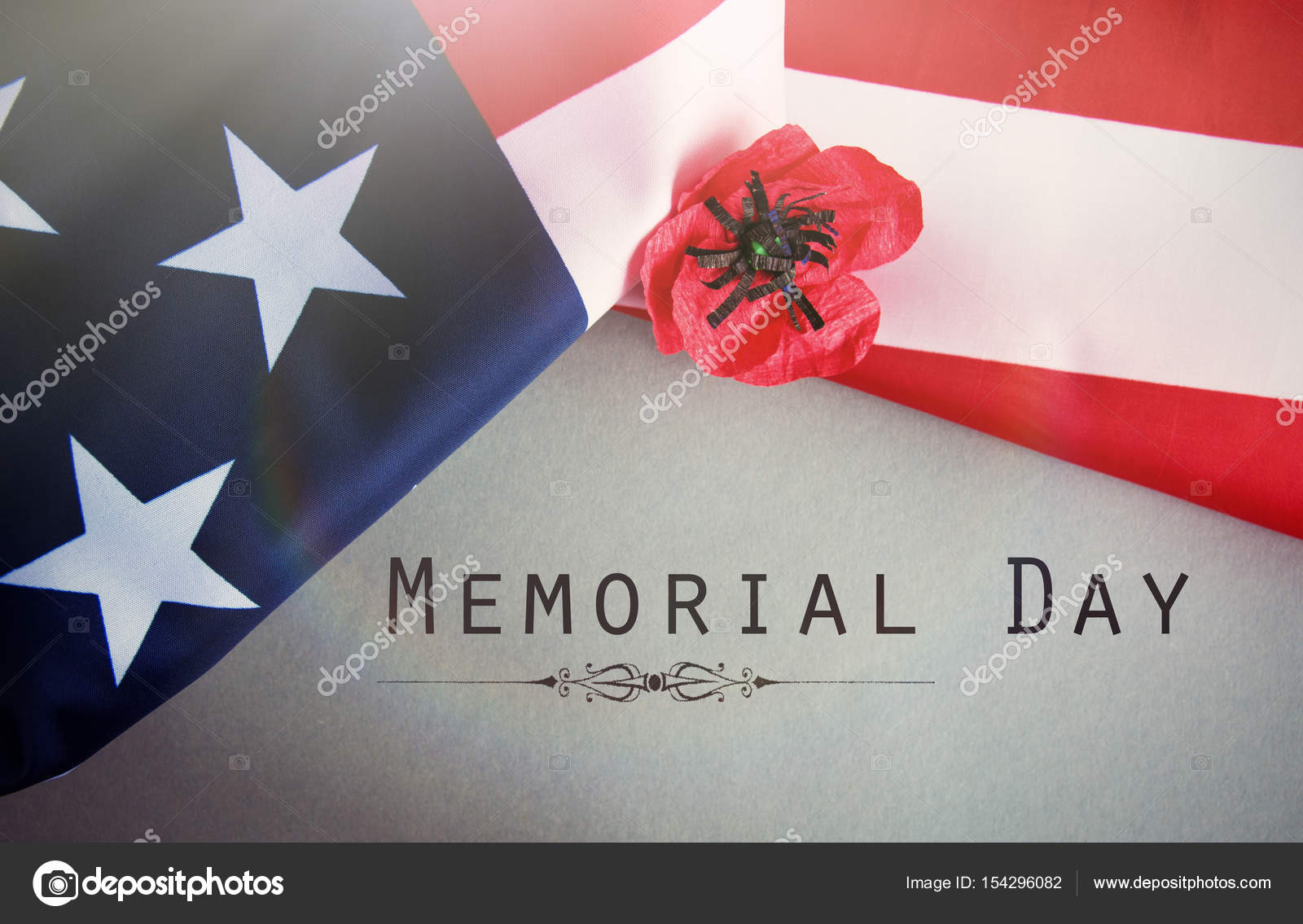 Text memorial day on american flag and a poppy flower background text memorial day on american flag and a poppy flower background stock photo mightylinksfo