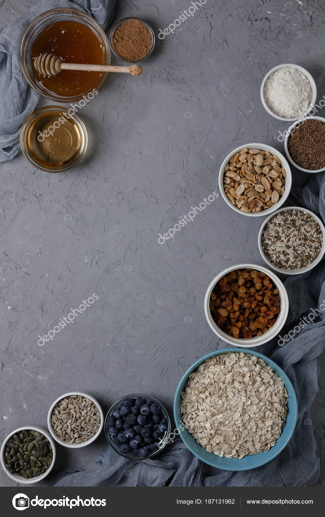 Ingredients for cooking homemade granola: oatmeal, raisins, coconut