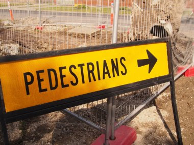 Pedestrian sign besides road works