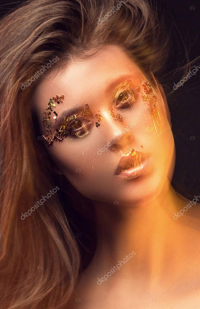 Portrait of a girl, model with beautiful, creative make-up in th