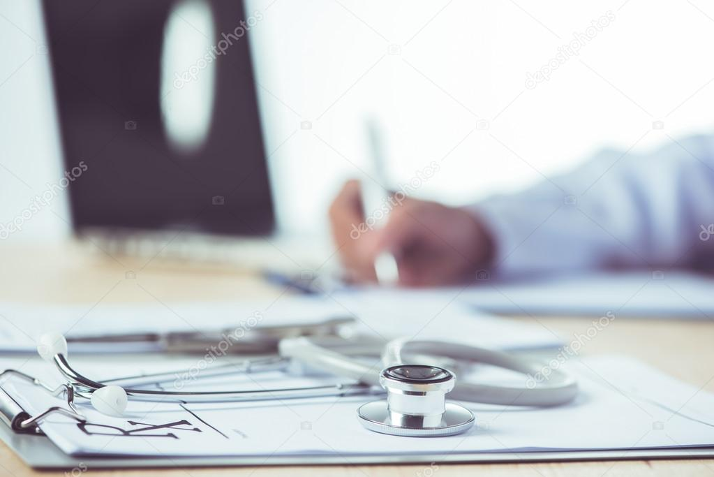 Doctor completing a Medical Claim Form