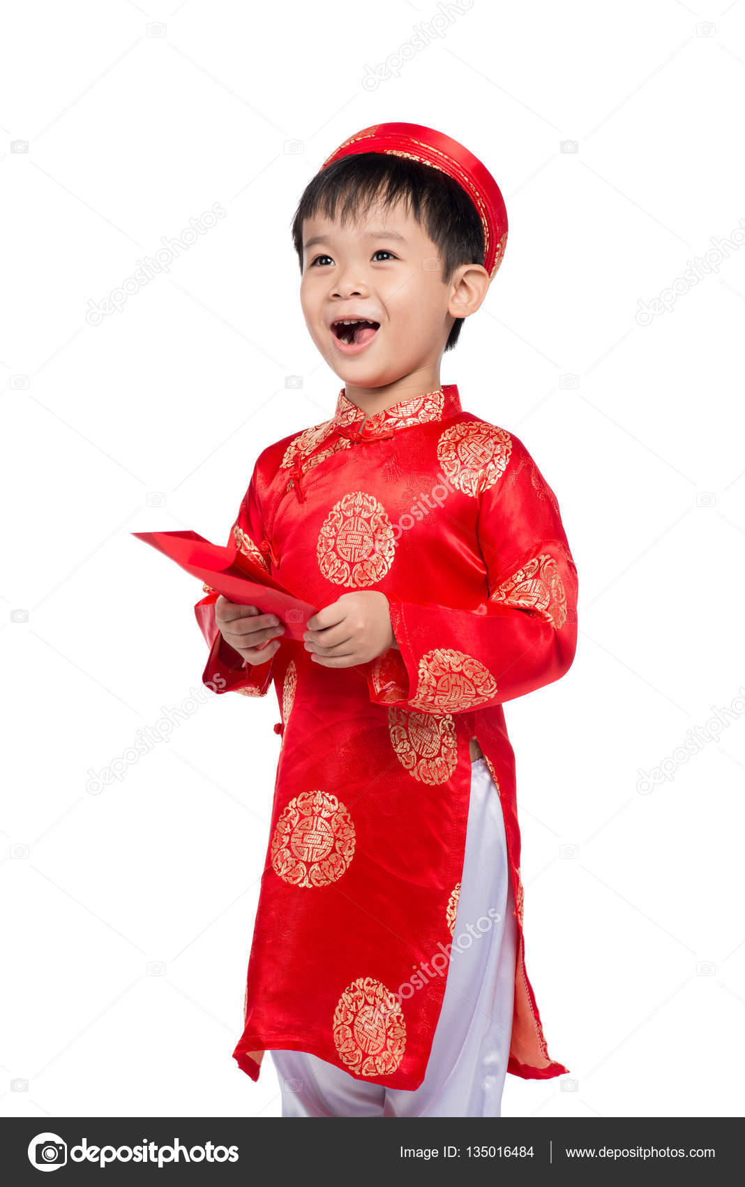 Little Vietnamese boy in traditional clothes for Tet celebration. The word mean double happiness. It is the gift in lunar new year or Tet Holiday on red ...
