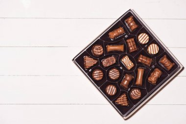 box with various chocolate candies