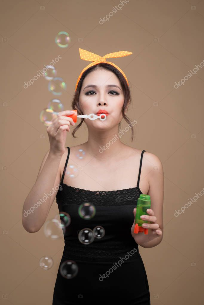 woman blowing party bubbles