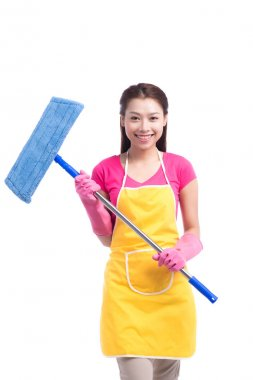 housewife cleaning floor with mop