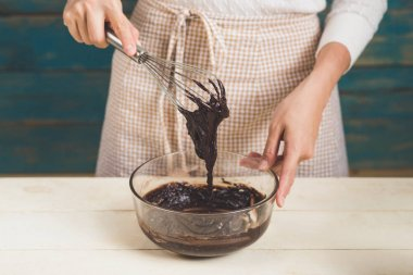 woman making chocolate cake.