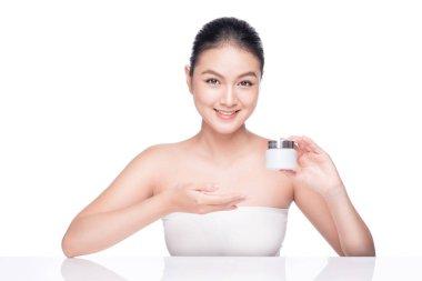 woman holding moisturizing cream box