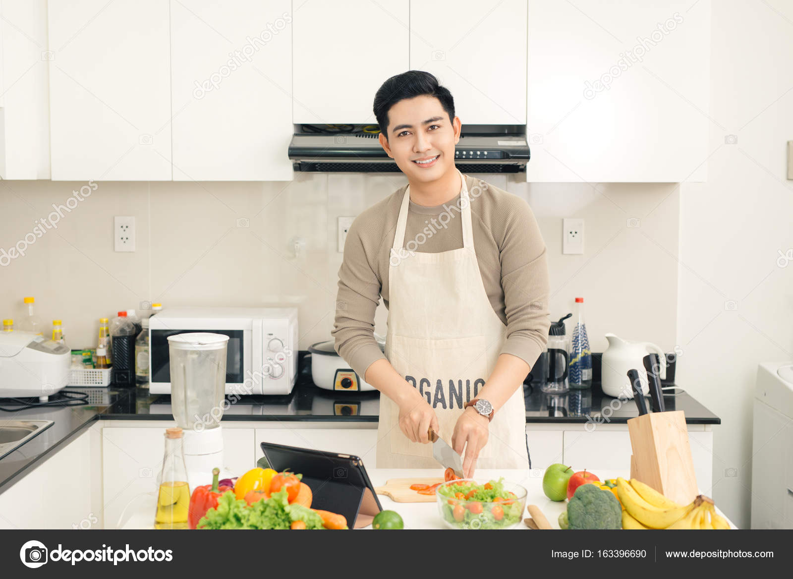 Young asian handsome man preparing food in kitchen at home — Stock ...