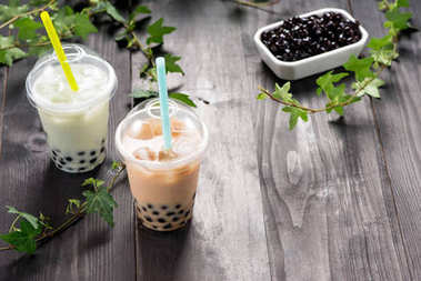 Milky bubble tea with tapioca pearls in plastic cup