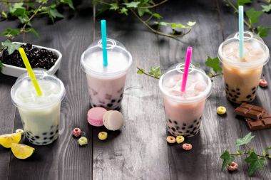 Milky bubble tea with tapioca pearls in plastic cups