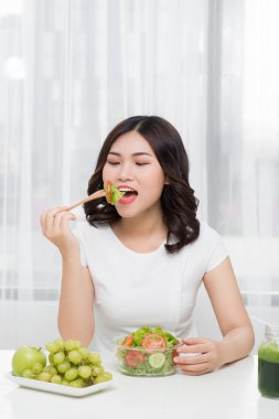 Young woman eating salad. Weight loss concept stock vector