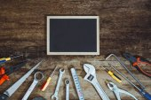 Fotografie Labor day. Construction tools with blank chalkboard