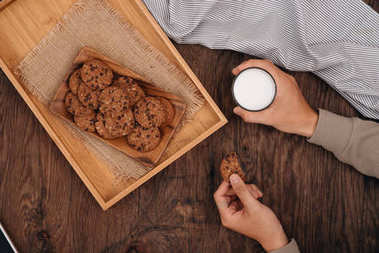 Delicious chocolate chip cookies on a tray on dark old wooden table
