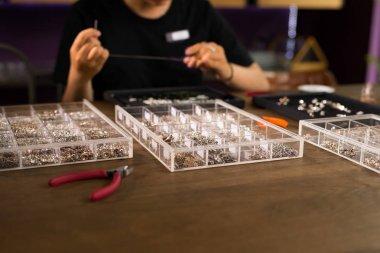 Jeweler making of handmade stone beads jewellery.