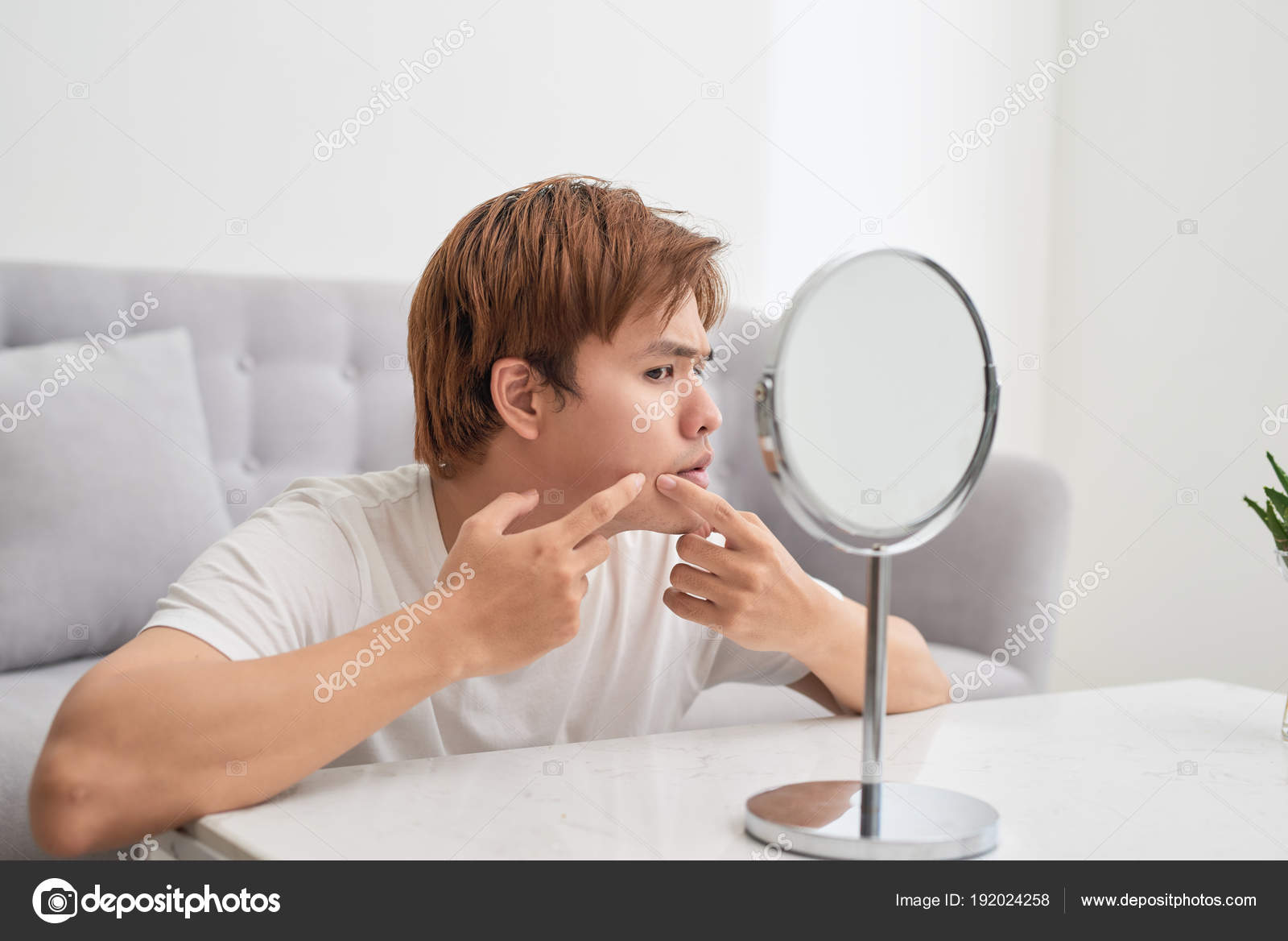 asian man looking mirror popping pimple stock photo makidotvn