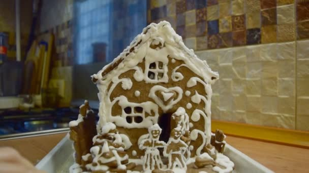 The handmade holiday gingerbread house and cookies.
