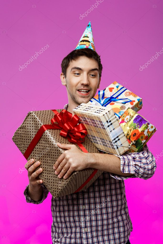 Happy Young Man Holding Birthday Gifts In Boxes Over Purple Background Copy Space Photo By Nkkravchenkogmail