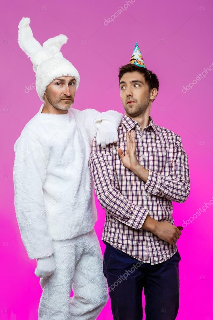 Drunk man and rabbit at birthday party over purple background.