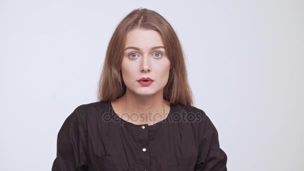 Young beautiful shocked fair-haired girl over white background