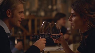 male and female lovers sitting at restaurant