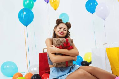 Closeup portrait of smiling girl hugging big present box