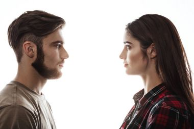 Side view. Man and woman facing each other, eyes open.