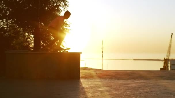 male jumping from parapet on skateboard