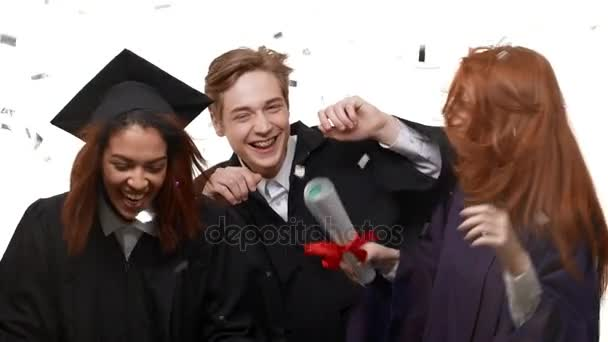 graduate students happily rejoicing