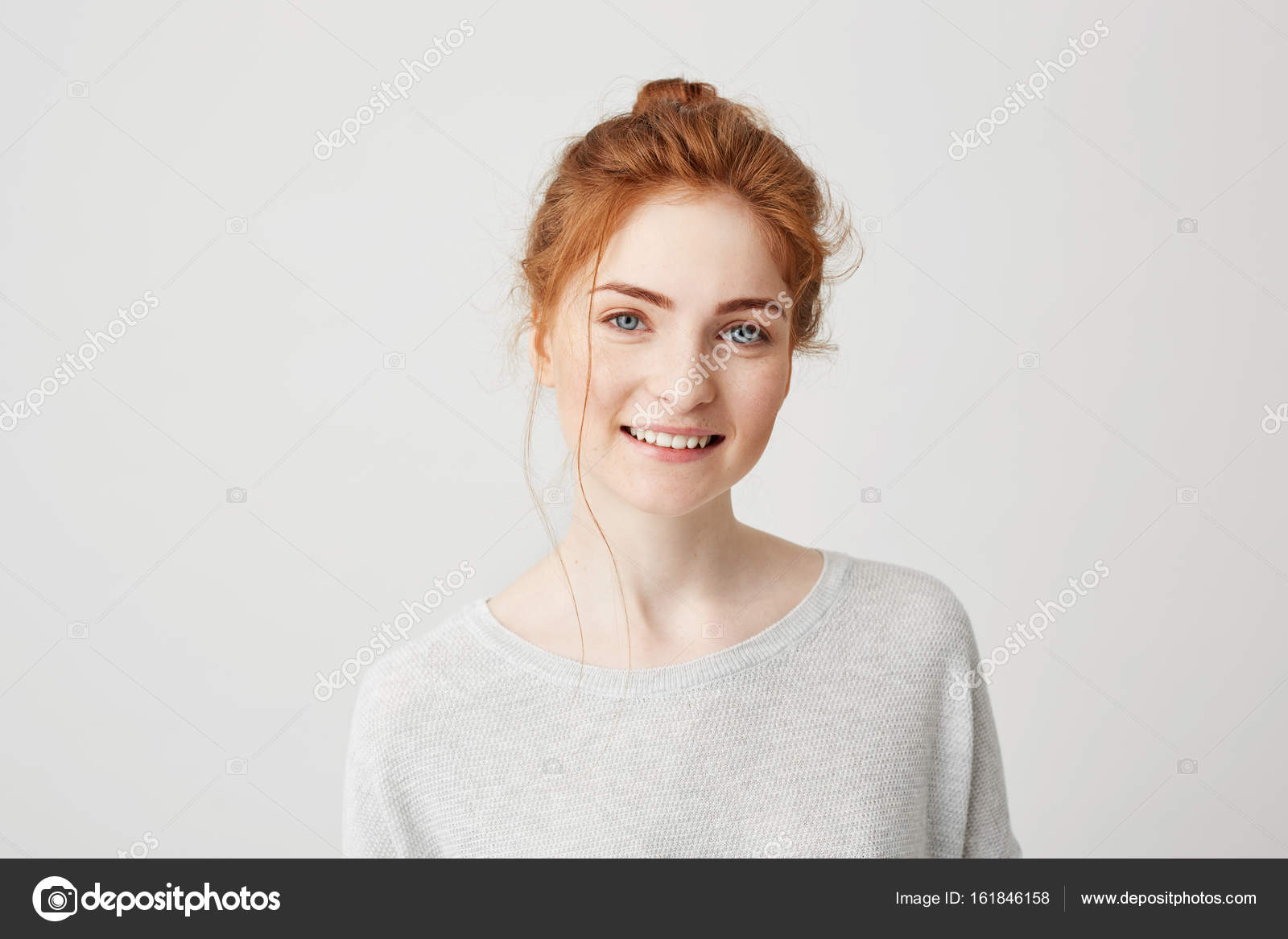 portrait of happy tender ginger girl with blue eyes and freckles