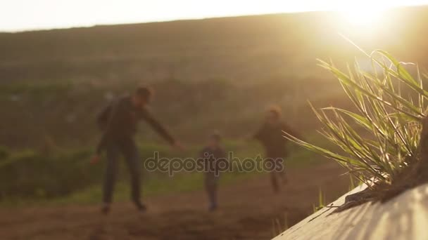 multiethnic family running and having fun during sunrise alfresco in slowmotion. Concept of friendly family.