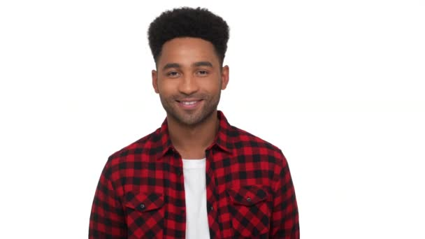 portrait of happy glad dark-skinned guy in red plaid shirt looking on camera smiling broadly with white teeth over white background. Concept of emotions