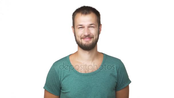 horizontal portrait of optimistic bearded man wearing shirt looking on camera smiling showing hand welcoming greeting over white background closeup. Concept of emotions
