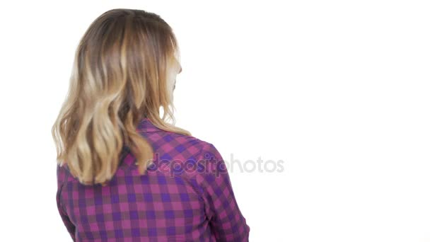 portrait from back of charming woman 30s with dyed blond hair turning around on camera with brilliant smile being flirty over background copy space. Concept of emotions