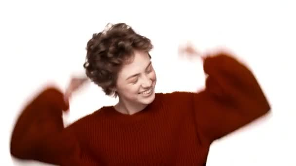 Portrait of happy woman being ecstatic about reaching goals and clenching fists like winner or successful person over white background. Concept of emotions