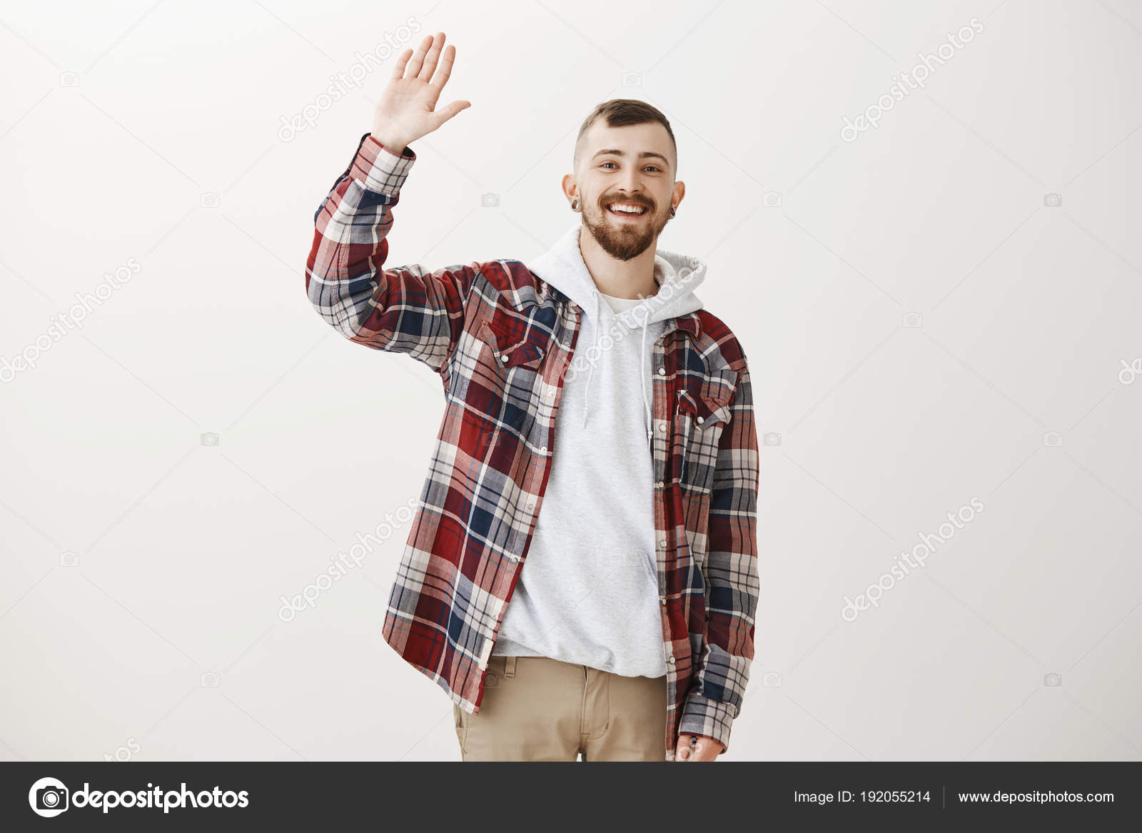 Carefree friendly male student in stylish clothes raising palm to carefree friendly male student in stylish clothes raising palm to give high five greeting m4hsunfo