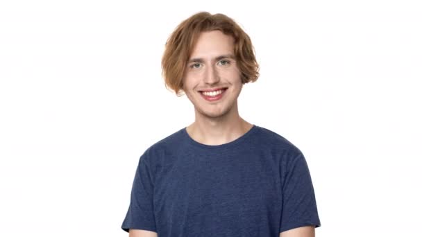 Portrait of happy hairy man in casual t-shirt looking on camera and smiling with perfect teeth, isolated over white background. Concept of emotions