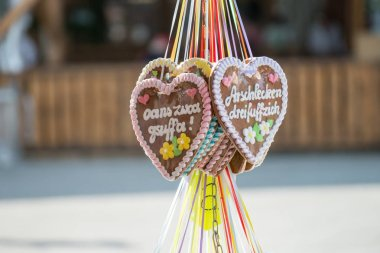 Gingerbread heart at a folk festival with german words - one two drinking - Costs for kissing ass 3 50, Germany