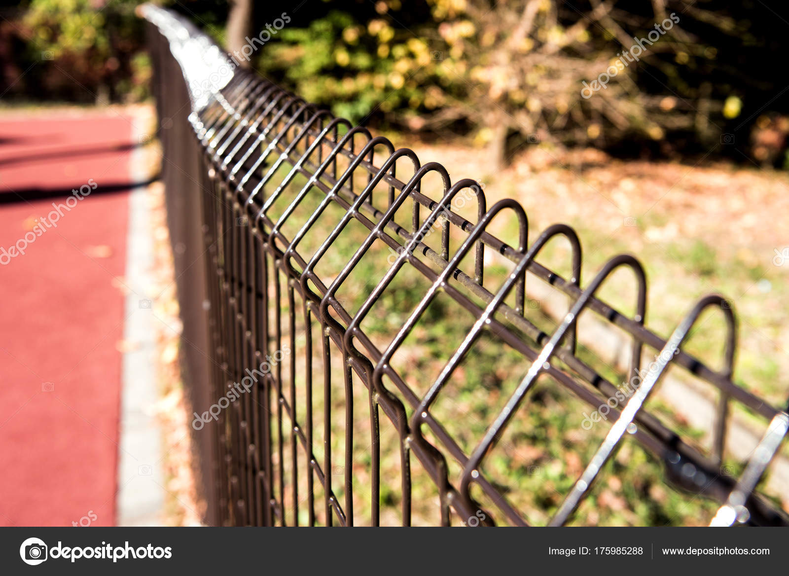 Steel grating fence of soccer field,Metal fence wire with grass ...