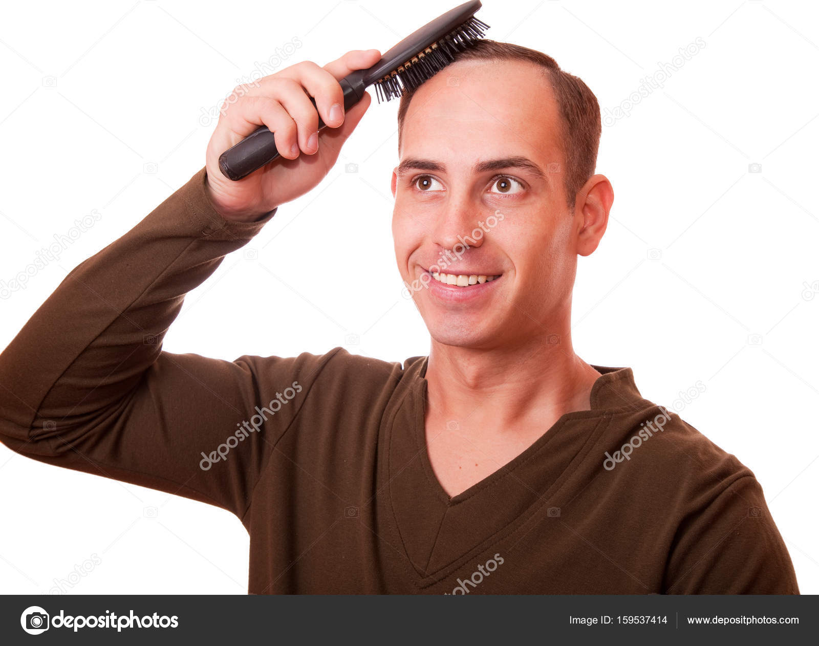 Young Man Combing The Hair Of A White Background Stock